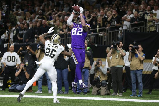 Minnesota Vikings tight end Kyle Rudolph catches the game-winning touchdown in overtime to beat the New Orleans Saints during wild-card weekend.