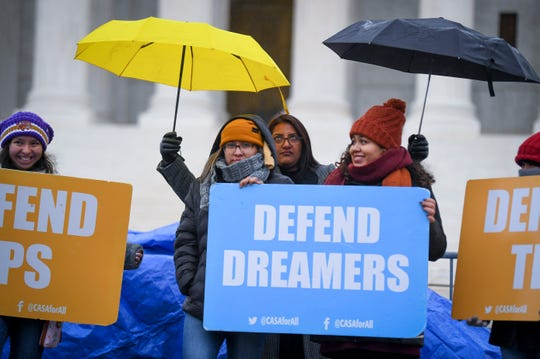 Demonstrators stand in the cold and rain outside the Supreme Court in November during oral argument on the Trump administration's decision to end the Deferred Action for Childhood Arrivals (DACA) program.