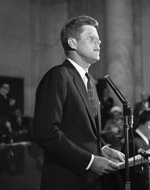 In this Jan. 2, 1960, file photo, Sen. John F. Kennedy, D-Mass., formally announces at a news conference in Washington that he is a candidate for the Democratic presidential nomination. A handwritten draft Kennedy's announcement speech is among hundreds of items associated with the late president to be auctioned in January 2020, by the Boston-based RR Auction.