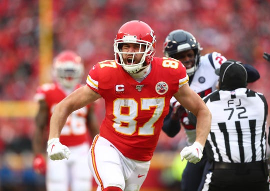 Kansas City Chiefs tight end Travis Kelce celebrates a play against the Houston Texans in the first half of the AFC Divisional Round playoff football game at Arrowhead Stadium.