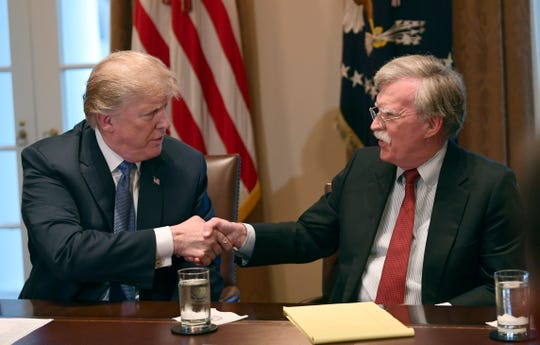 President Donald Trump and national security adviser John Bolton at the White House in Washington on April 9, 2018.