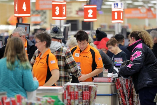 Fleet Farm's familiar orange-shirted employees will continue to serve customers for years to come. The store was busy on Black Friday 2019 in this file photo.