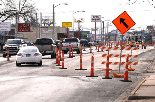 Motorists navigate the traffic cones on Butternut Street Tuesday.