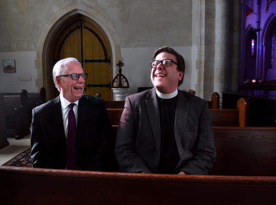 The Rev. Cliff Stewart (left) and the Rev. David Romanik share a joke inside a chapel at Episcopal Church of the Heavenly Rest, where Romanik is rector.