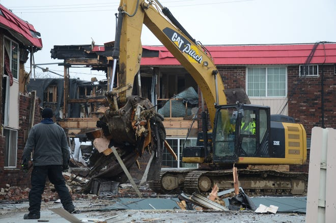 Investigators use heavy equipment Tuesday as they continue to search for the cause of the December fire at the Econo Lodge in Battle Creek.