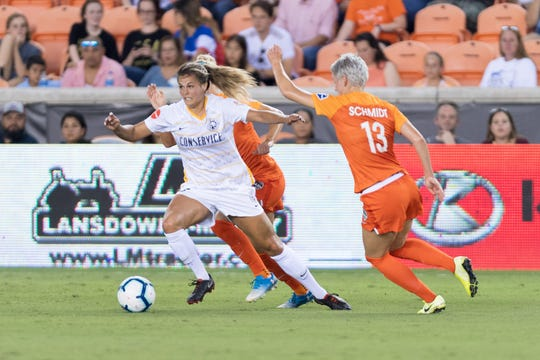 Katie Stengel, left, of Utah, seen in last season's NWSL game against Houston, is now with the Dash.
