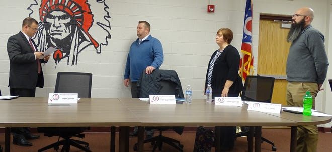 Bucyrus City Schools Treasurer Ryan Cook, left, administers the oath of office to new board members Randy Blankenship, Christa Graves and Dave Jones in January. At the board's October meeting, members will begin the process of deciding whether the district will change its mascot.