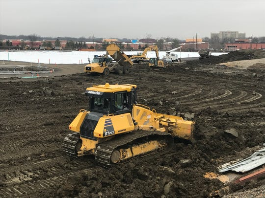 Workers prepare the site of a future Costco Wholesale club in Cherry Hill.
