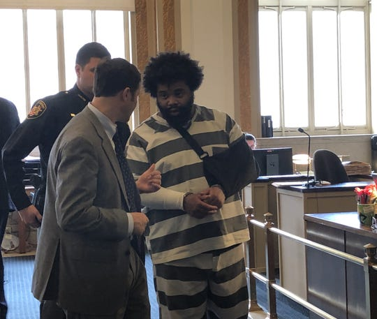 Jonathan Green, in the jail uniform, talks to his attorney, Scott Rubenstein, after being sentenced to 12 years in prison on charges including involuntary manslaughter on Tuesday, Jan. 14, 2020 in Hamilton County Common Pleas Court.