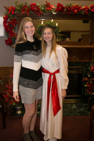 Sisters, Candace and Nicole Walson. Candace was the 2018 Lucia.