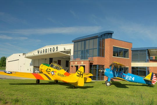 The Tri-State Warbird Museum planes rest on the lawn of the Clermont County Airport.