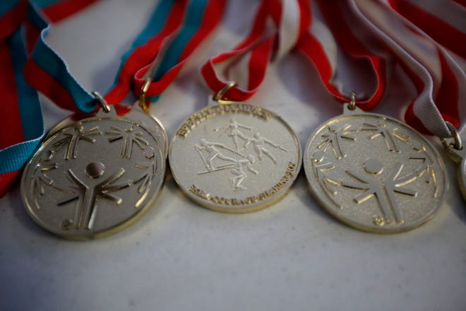 Special Olympics gold medals.