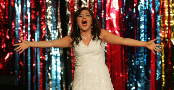 """Gabby Clutter performs """"The Girl in 14G"""" during the 11th annual Indianola High School Show Choir Cabaret in 2014. Clutter, a soprano, has advanced to the regional level in this year's Metropolitan Opera National Council Auditions."""