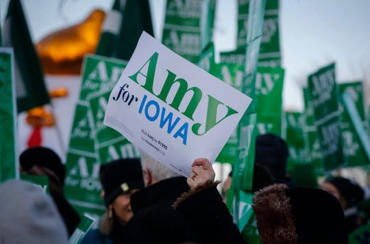 Supporters of Democratic presidential candidate hopeful Amy Klobuchar gather to chant and unite prior to the Democratic debate at Drake University in Des Moines on Tuesday, Jan. 11, 2020.
