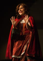 """Gabby Clutter sings """"I Know Things Now"""" from the musical """"Into the Woods"""" in a spotlight performance in 2012 during the ninth annual Indianola High School Show Choir Cabaret. Clutter, a soprano, has advanced to the regional level in this year's Metropolitan Opera National Council Auditions."""