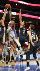 Andre Drummond scores over Pelicans' Jahlil Okafor at LCA on Jan. 13.