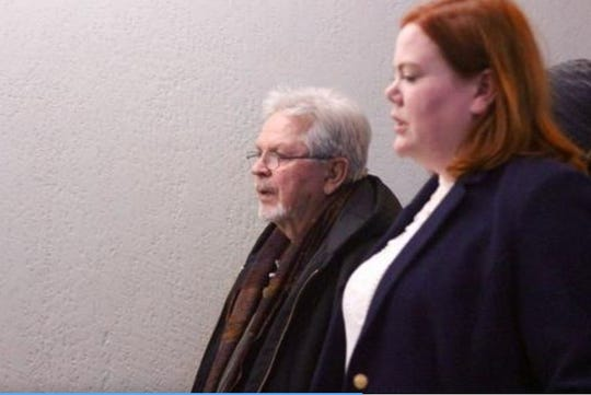 James Chance, left, exits the courtroom with attorney Laura Joyce Jan. 13, 2020, after being found guilty of accessory after the fact to the mutilation of a body.