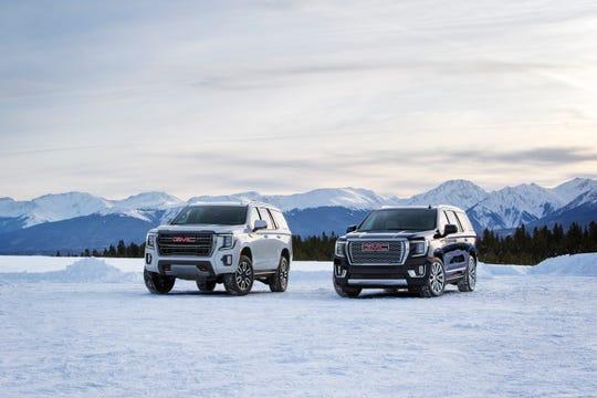 2021 GMC Yukon AT4, left, and Denali