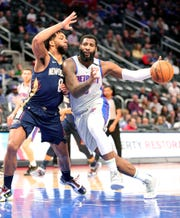 Andre Drummond drives against Jahlil Okafor during the first period at Little Caesars Arena on Monday.