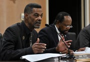 City council vice president Eric Mays, left, speaks at a Flint city council meeting at the city hall in Flint, Mich. on Jan. 13, 2020.