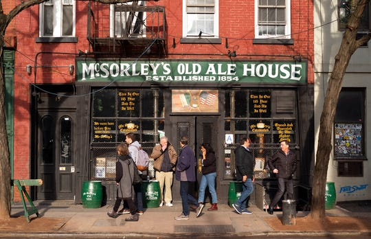 In this Dec. 27, 2019 photo, people come and go from McSorley's Old Ale House in New York. Located in Manhattan's Lower East Side, McSorley's opened in the mid-19th century, functioned as a speakeasy during Prohibition, and continues in operation today.