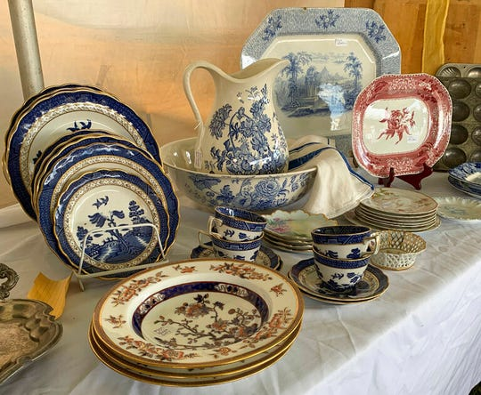 This Sept. 7, 2019 photo provided by Tracee Herbaugh shows shows a variety of china for sale at the Brimfield Flea Market in Brimfield, Mass.