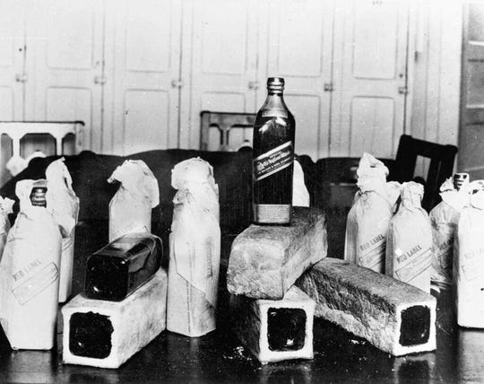 In this June 12, 1924, file photo bottles of Scotch whiskey smuggled in hollowed-out loaves of bread are pictured, location unknown.