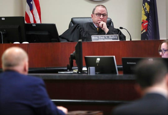 Ozaukee County Circuit Judge Paul Malloy listens to attorneys from both sides Monday, Jan. 13, 2020 before making his finding at the Ozaukee County Courthouse in Port Washington, Wis., where he held state election officials in contempt of court for not following his order to remove thousands of people from the voters rolls.