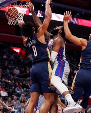 Pistons center Andre Drummond, center, dunks on Pelicans center Jahlil Okafor here on Monday. Drummond was pulled from the game with 3:29 left in the third quarter and watched the rest from the bench.