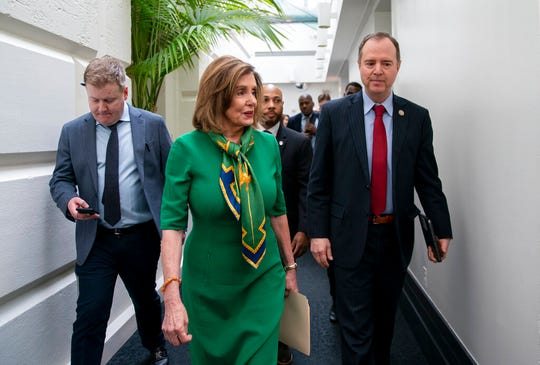 Speaker of the House Nancy Pelosi, D-Calif., joined by House Intelligence Committee Chairman Adam Schiff, D-Calif., leaves a lengthy closed-door meeting with the Democratic Caucus at the Capitol in Washington, Tuesday, Jan. 14, 2020. Speaker Pelosi is expected to appoint House impeachment managers and transmit the two articles of impeachment ( abuse of power and obstruction of Congress ) by the end of the week.