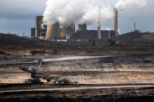 A mining machine is working in the Inden opencast lignite mine in Schophoven, Germany, Tuesday, Jan.14, 2020.