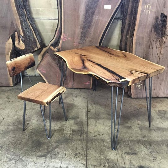 The lines and story of what was once a butternut tree show is this custom made desk and chair handcrafted at Tree-Purposed Detroit, a sawmill and workshop in Livonia.