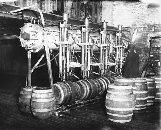 In this March 21, 1931, file photo dry agents seize 7,000 barrels of beer in Newark raid, Calif. Prohibition greatly expanded federal law enforcement powers and turned millions of Americans into scofflaws. It provided a new revenue stream for organized crime.