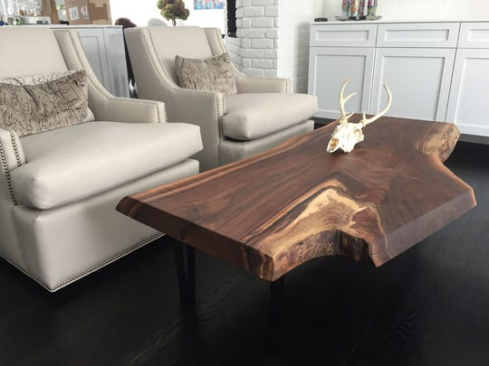 A live edge coffee table by Tree-Purposed Detroit.