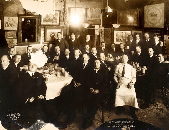 In this Jan. 13, 1920 photo provided by McSorley's Old Ale House, clients and staff pose in the New York bar shortly before the beginning of Prohibition.