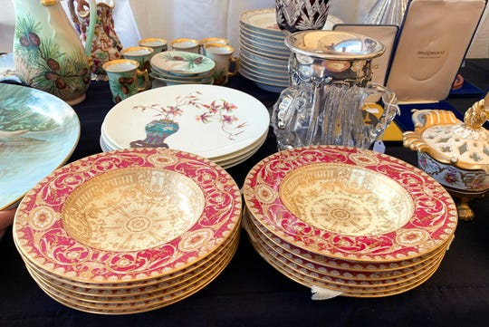This Sept. 7, 2019 photo provided by Tracee Herbaugh shows some of the china for sale at a flea market in Brimfield, Mass. China has become a staple at flea markets, as younger people opt to sell or donate heirloom dishware.