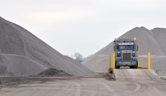 A gravel-train semi pulls onto a scale at Detroit Bulk Storage on Tuesday.