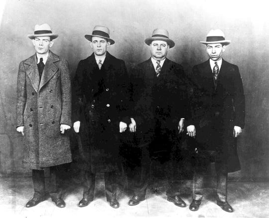 """In this Oct. 20, 1930, file photo from left, gangsters Ed Diamond, Jack Diamond, Fatty Walsh and Charles """"Lucky"""" Luciano pose for a photo in New York. It's simplistic to say Prohibition created organized crime in America, but it fueled a huge expansion as local crime gangs collaborated with those from other regions to establish shipping systems and set prices for bootlegged alcohol."""