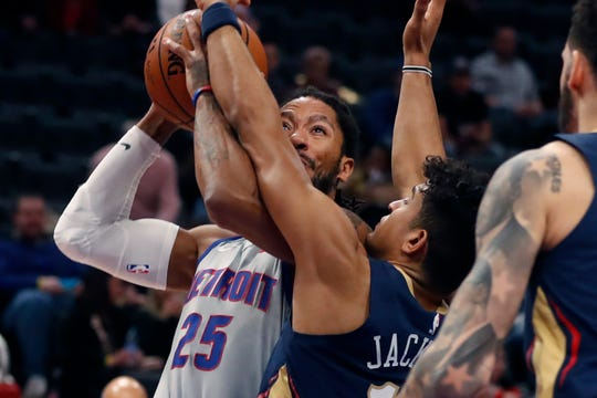 New Orleans Pelicans guard Frank Jackson (15) reaches in on Detroit Pistons guard Derrick Rose (25) during the first half.