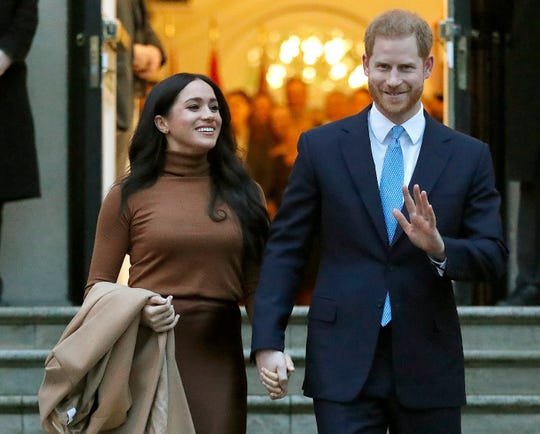 Britain's Prince Harry and Meghan, Duchess of Sussex leave after visiting Canada House in London, Jan. 7, 2020.