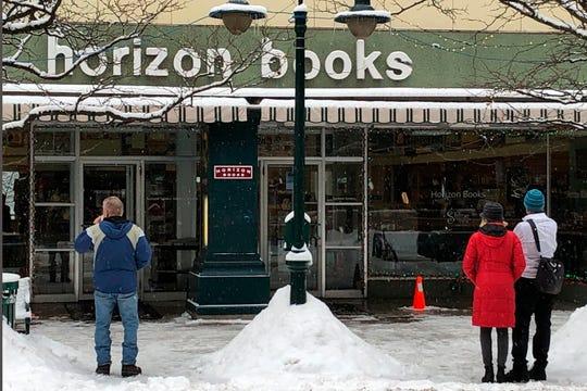 People outside Horizon Books Monday in Traverse City.