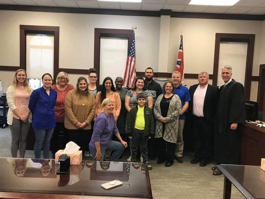 CASA volunteers are sworn in in Seneca County in the juvenile court with Judge Jay Meyer, left.