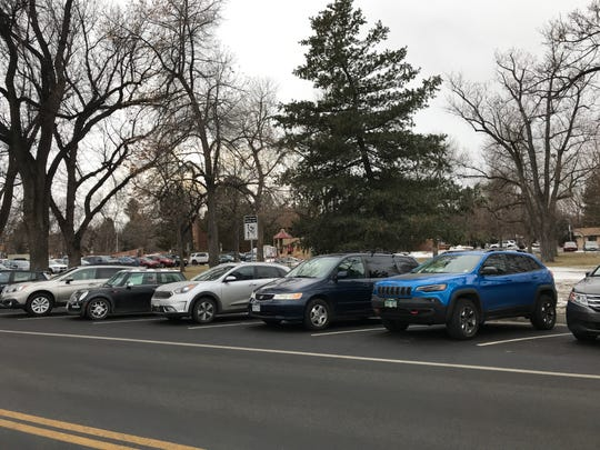 Back-in angled parking is required on Howes Street between Maple Street and Laporte Avenue.