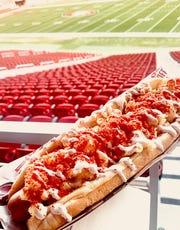 A footlong hot dog covered in mac and cheese and Flamin' Hot Cheeto dust is part of the special playoff menu at Levi's Stadium for the 49ers and Packers NFC Championship game in Santa Clara, Calif.