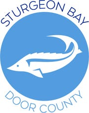 Destination Sturgeon Bay's new logo features a sturgeon graphic and a wide capital-letter font.