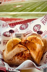 A dungeness crab sandwich with lemon, chives, and Old Bay seasoning is part of the special playoff menu at Levi's Stadium for the 49ers and Packers NFC Championship game in Santa Clara, Calif.