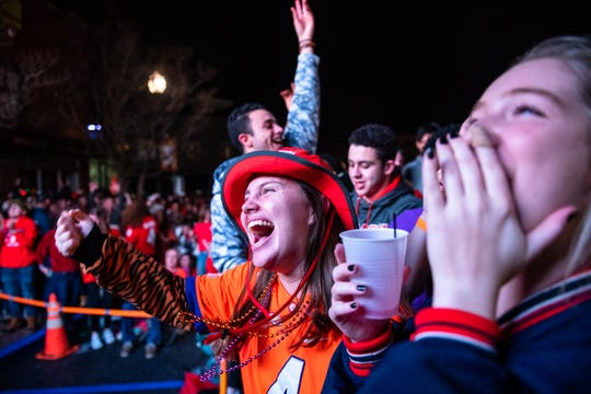 Savannah Jones cheers with other Clemson students in downtown Clemson on College Ave. for a watch party where the Clemson Tigers football team's national championship game against LSU in New Orleans was broadcast Monday, January 13, 2020. LSU won 42-25.