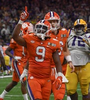 Clemson running back Travis Etienne (9) celebrates after a touchdown during the third quarter of the National Championship game at the Mercedes Benz Superdome in New Orleans Monday, January 13, 2020.