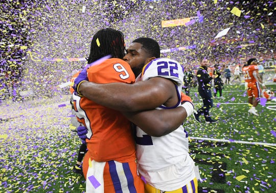 Clemson running back Travis Etienne (9) hugs LSU running back Clyde Edwards-Helaire (22) after the National Championship game at the Mercedes Benz Superdome in New Orleans Monday, January 13, 2020.