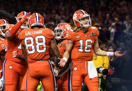Clemson quarterback Trevor Lawrence (16) reacts after a 36-yard touchdown to wide receiver Tee Higgins (5) during the second quarter of the National Championship game at the Mercedes Benz Superdome in New Orleans Monday, January 13, 2020.